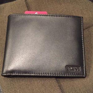 Tumi black leather wallet